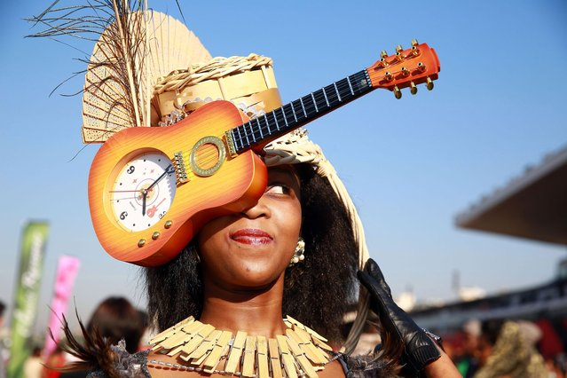 A woman poses as she arrives dressed up for a fashion competition during the annual Durban July horse race on July 5, 2014, in Durban, South Africa. The Durban July horse race is the biggest horse racing event on the African continent and a high social event where South African celebrities dress up and watch the race. It attracts close to 100,000 spectators and bets are placed in excess of 20 million US dollars. (Photo by Rajesh Jantilal/AFP Photo)