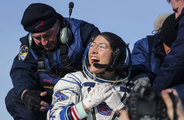 U.S. astronaut Christina Koch reacts shortly after the landing of the Russian Soyuz MS-13 space capsule about 150 km ( 80 miles) south-east of the Kazakh town of Zhezkazgan, Kazakhstan, Thursday, February 6, 2020. A Soyuz space capsule with U.S. astronaut Christina Koch, Italian astronaut Luca Parmitano and Russian cosmonaut Alexander Skvortsov, returning from a mission to the International Space Station landed safely on Thursday on the steppes of Kazakhstan. Koch wrapped up a 328-day mission on her first flight into space, providing researchers the opportunity to observe effects of long-duration spaceflight on a woman as the agency plans to return to the Moon under the Artemis program. (Photo by Sergei Ilnitsky/Pool Photo via AP Photo)