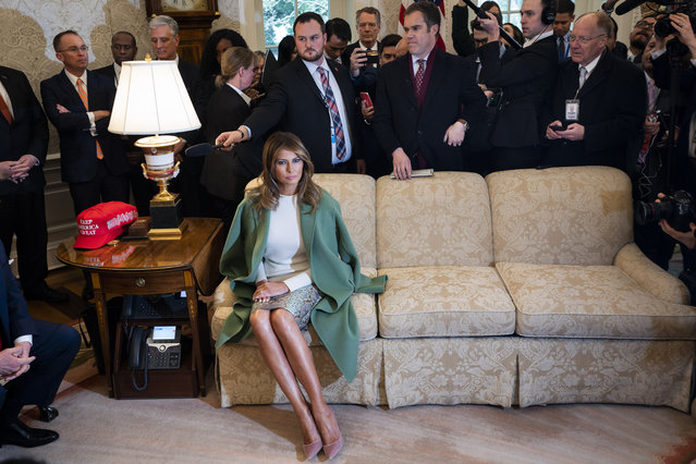 First Lady Melania Trump listens to US President Donald Trump and Ecuadorian President Lenin Moreno (not pictured) speak to the media in the Oval Office of the White House in Washington DC, US on February 12, 2020. (Photo by Rex Features/Shutterstock)
