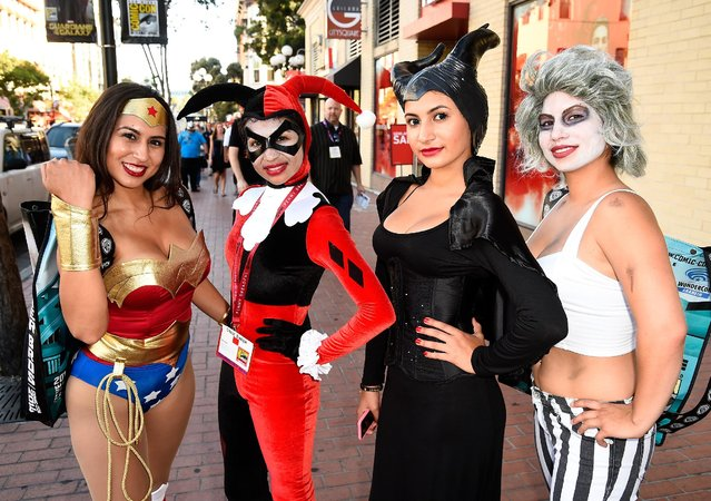 Guests attend Day 1 of Comic-Con International 2014 on July 24, 2014 in San Diego, California. (Photo by Frazer Harrison/AFP Photo)