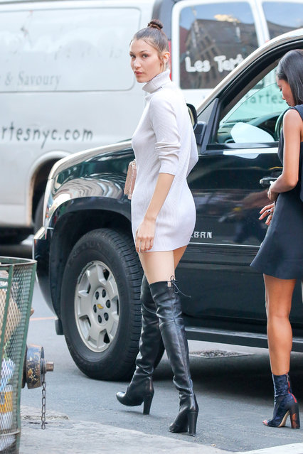 Bella Hadid looks over her shoulder while goes to Mr Chow in Tribeca, New York City, New York on June 30, 2016. The model wore a sweater dress and thigh-high black boots. (Photo by Felipe Ramales/Splash News)