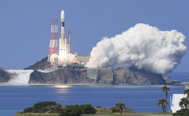 A H-IIA rocket carrying Michibiki 3 satellite, one of four satellites that will augment regional navigational systems, lifts off from the launching pad at Tanegashima Space Center on the southwestern island of Tanegashima, Japan, in this photo taken by Kyodo August 19, 2017. (Photo by Reuters/Kyodo News)