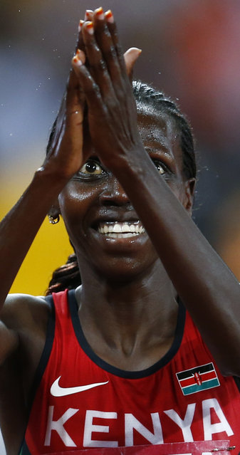 Hyvin Kiyeng Jepkemoi of Kenya reacts after winning the women's 3000 metres steeplechase final at the IAAF World Championships at the National Stadium in Beijing, China August 26, 2015. (Photo by David Gray/Reuters)