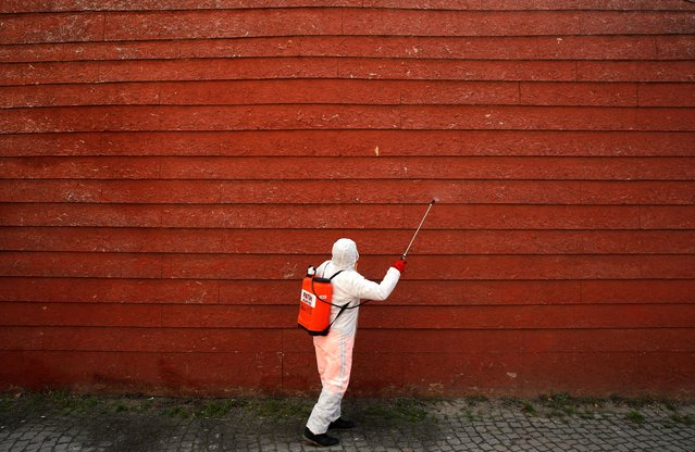 A worker in protective suit disinfects the wall of a mosque in response to the spreading coronavirus disease (COVID-19) in Istanbul,Turkey on March 20, 2020. (Photo by Umit Bektas/Reuters)