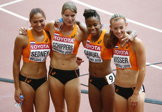 (L-R) Naomi Sedney of the Netherlands poses with her teammates Dafne Schippers, Jamile Samuel and Nadine Visser after their women's 4 x 100 metres relay heat at the 15th IAAF Championships at the National Stadium in Beijing, China August 29, 2015. (Photo by David Gray/Reuters)