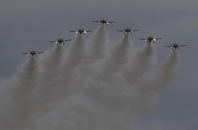 Spanish Air Force Patrulla Aguila performs during the Air14 airshow at the airport in Payerne August 31, 2014. The Swiss Air Force celebrates their 100th anniversary with the biggest airshow in Europe this year. (Photo by Denis Balibouse/Reuters)