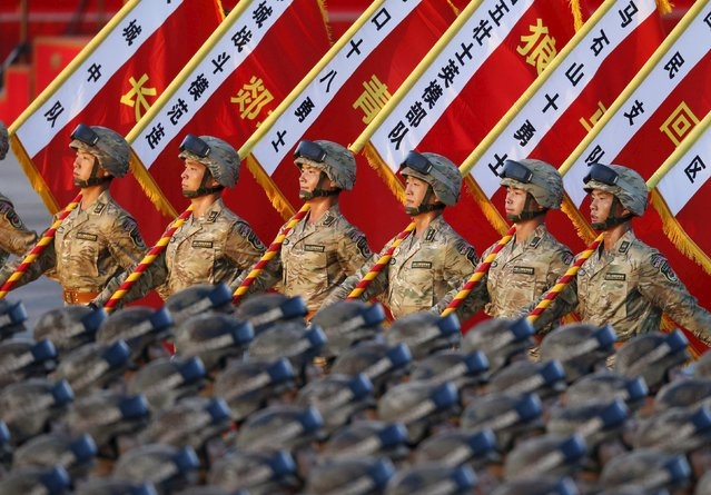 Soldiers of the People's Liberation Army (PLA) of China stand in formation as they gather ahead of a military parade to mark the 70th anniversary of the end of World War Two, in Beijing, China, September 3, 2015. (Photo by Reuters/Stringer)