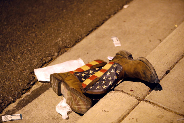 A pair of cowboy boots is shown in the street outside the concert venue after a mass shooting at a music festival on the Las Vegas Strip in Las Vegas, Nevada on October 1, 2017. (Photo by Steve Marcus/Reuters/Las Vegas Sun)