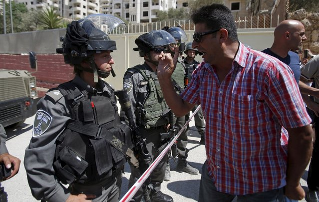 A Palestinian argues with Israeli border police during a protest against what organizers say is land confiscation by Israel to make way for the Israeli barrier in the occupied West Bank city of Beit Jala, near Bethlehem September 6, 2015. (Photo by Mussa Qawasma/Reuters)
