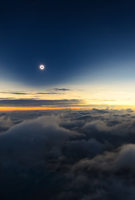 """Totality From Above the Clouds"". A fantastic view of one of nature's greatist spectacles, a total solar eclipse, taken from an airplane, 3200m above Turkana Kenya. The photographer was due to shoot this rare occurrence from the eastern shore of Lake Turkan but a huge sand-storm hit the region forty minites befor totality. (Photo by Catalin Beldea, Romania/The Astronomy Photographer of the Year 2014 Contest)"
