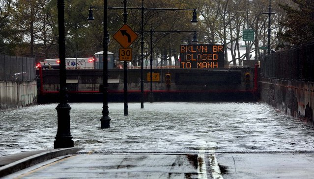 The Battery Park Underpass is submerged by floodwaters in New York City. (Photo by Michael Appleton/The New York Times)