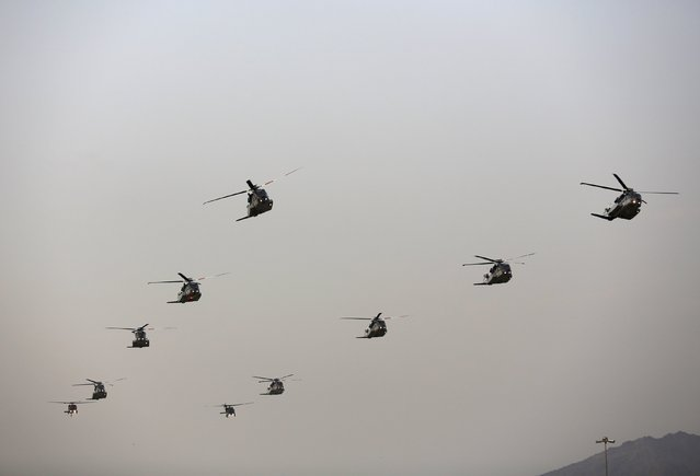 Helicopters fly in formation during a military parade in preparation for the annual Haj pilgrimage in Mecca September 17, 2015. (Photo by Ahmad Masood/Reuters)