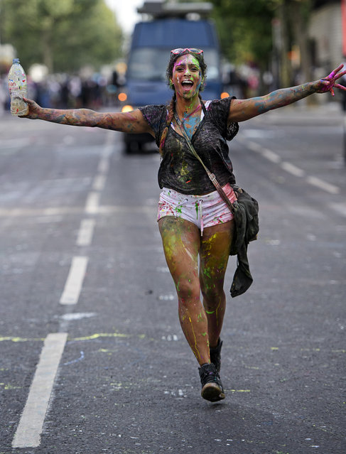 Revellers enjoy Jouvert, a paint fight that officially marks the start of the Notting Hill carnival in London, UK on August 28, 2016. The two day event is the second largest street festival in the world after the Rio Carnival in Brazil, attracting over 1 million people to the streets of West London. (Photo by Ben Cawthra/London News Pictures)