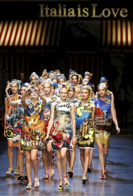 A model takes a selfie with mobile phone during the parade at the end of the Dolce & Gabbana Spring/Summer 2016 collection during Milan Fashion Week in Italy, September 27, 2015. (Photo by Stefano Rellandini/Reuters)