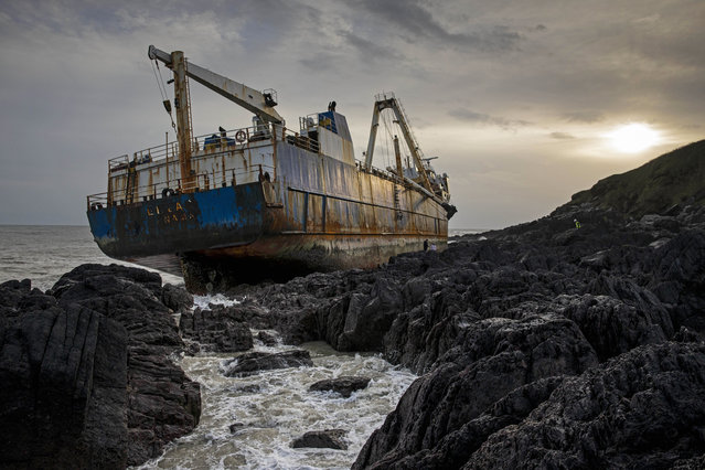 "The abandoned 77-metre (250-feet) cargo ship MV Alta is pictured stuck on rocks near the village of Ballycotton south-east of Cork in Southern Ireland on February 18, 2020. A ""ghost ship"" drifting without a crew for more than a year washed ashore on Ireland's south coast in high seas caused by Storm Dennis, the Republic's coast guard said. (Photo by Cathal Noonan/AFP Photo)"