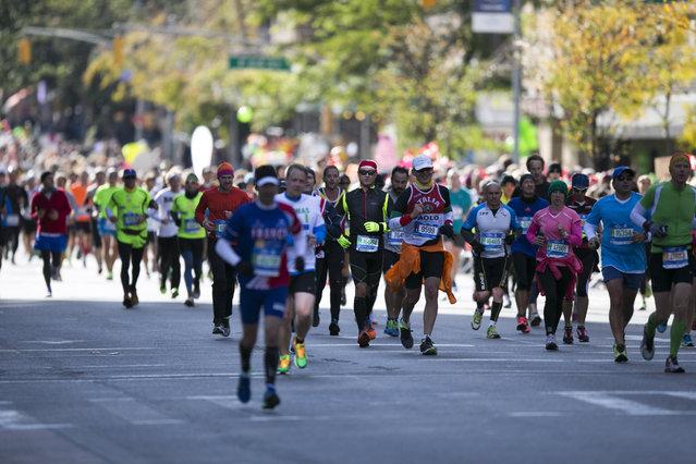 Runners head uptown towards the final leg of the 44th annual New York City Marathon in New York, Sunday, November 2, 2014. (Photo by Gordon Donovan/Yahoo News)