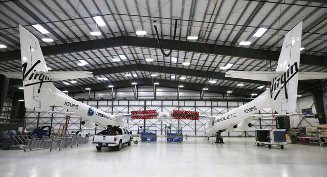 Virgin Galactic's WhiteKnightTwo carrier aircraft mothership, which landed safely after splitting from SpaceShipTwo, is seen in a hangar at Mojave Air and Space Port in Mojave. (Photo by Lucy Nicholson/Reuters)