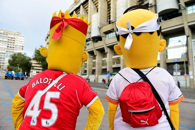 Real Madrid and Liverpool supporters dressed as characters from The Simpsons during the UEFA Champions League Group B match at the Santiago Bernabeu, Madrid, Spain, on November 4, 2014. (Photo by Adam Davy/PA Wire)