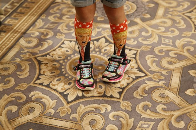 Eleven-year-old Millie March shows off her socks depicting Republican presidential candidate Donald Trump during a campaign event at Trump International Hotel, Friday, Sept. 16, 2016, in Washington. (AP Photo/ Evan Vucci) ORG XMIT: DCEV105