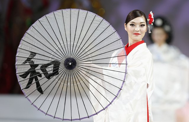 Lila Hongo of Japan poses in national dress during the 54th Miss International Beauty Pageant in Tokyo November 11, 2014. (Photo by Thomas Peter/Reuters)
