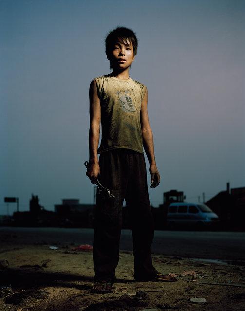 Wang Wei, 16,Truck mechanic. Xinmin, Liaoning. (Photo by Mathias Braschler and Monika Fischer)
