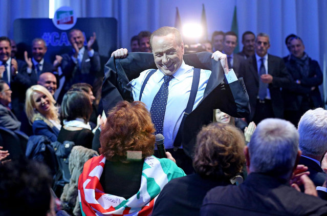 Italian former premier and Forza Italia (FI) leader Silvio Berlusconi takes off his jacket in order to show his pectoral  during the meeting with local FI administrators in Rome, Italy, 16 October 2015. (Photo by Alessandro Di Meo/EPA)