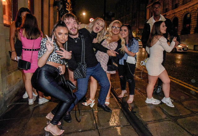 Revellers enjoy a night out in Newcastle, England on September 19, 2020 before pubs closed at 10pm. Almost two million people in north-east England will be banned from mixing with other households and pubs will close early as coronavirus cases rise. Health Secretary Matt Hancock announced the temporary restrictions will be in place from midnight due to concerning rates of infection. The measures affect seven council areas, Newcastle, Northumberland, North Tyneside, South Tyneside, Gateshead, County Durham and Sunderland. (Photo by North News and Pictures/The Sun)