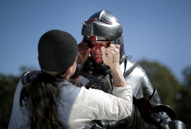Australian jouster Darrell Bossley has his helmet adjusted before presentation at the St Ives Medieval Fair, one of the largest of its kind in Australia, September 24, 2016. (Photo by Jason Reed/Reuters)