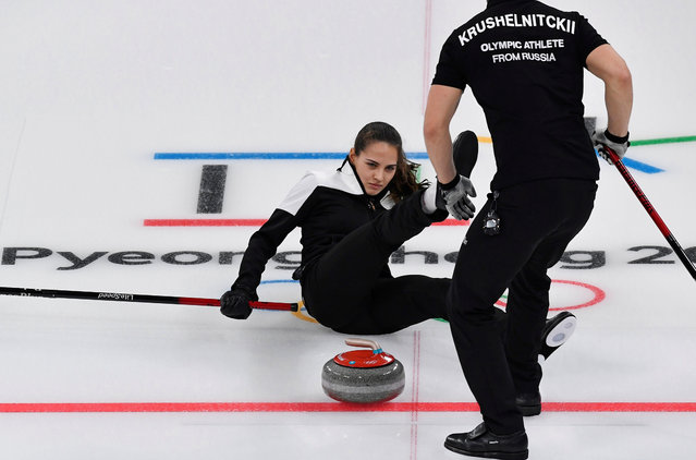 Anastasia Bryzgalova of Olympic Athletes from Russia falls as she competes against Norway during the Curling Mixed Doubles Bronze Medal Game on day four of the PyeongChang 2018 Winter Olympic Games at Gangneung Curling Centre on February 13, 2018 in Gangneung, South Korea. (Photo by Toby Melville/Reuters)
