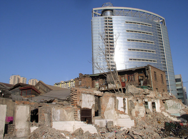 Tianjin's crumbling past juxtaposed against its shiny present. (Photo by Tom Carter/The Atlantic)