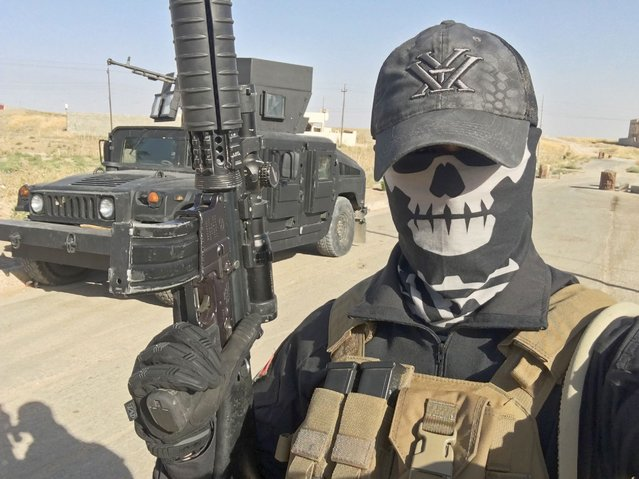 """This selfie provided to AFP on August 18, 2016 shows """"Mike"""" aka Peshmerganor, a Norwegian former soldier who is volunteering to help peshmerga forces fight the Islamic State group north of Mosul in and around Telskuf, Iraq. """"Mike"""" requested anonymity for security reasons. Increasing numbers of Westerners – many of them military veterans – appear to be trying to join the fight against the Islamic State group in Iraq before it's too late, front-line volunteer warriors say. (Photo by AFP Photo/Stringer)"""