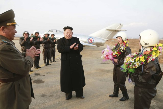 North Korean leader Kim Jong Un applauds as he provides field guidance to the flight drill of female pilots of pursuit planes of the KPA Air and Anti-Air Force in this undated photo released by North Korea's Korean Central News Agency (KCNA) in Pyongyang November 28, 2014. (Photo by Reuters/KCNA)