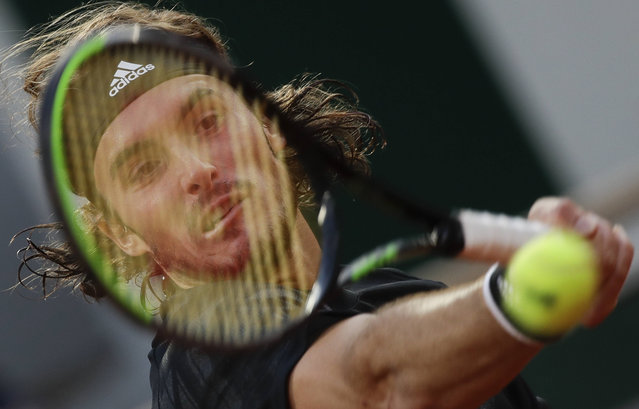 Greece's Stefanos Tsitsipas plays a shot against Russia's Andrey Rublev in the quarterfinal match of the French Open tennis tournament at the Roland Garros stadium in Paris, France, Wednesday, October 7, 2020. (Photo by Alessandra Tarantino/AP Photo)