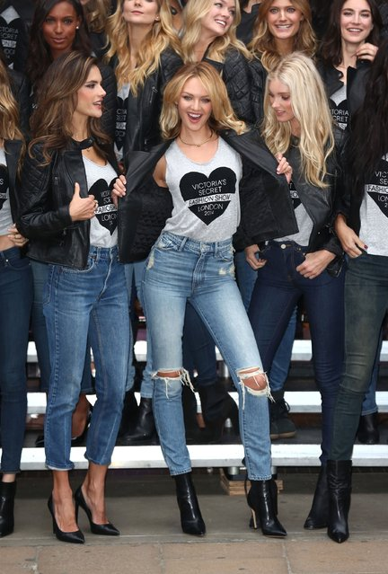 Alessandra Ambrosio and Candice Swanepoel attend a photocall for the Victoria's Secret Angels ahead of the annual fashion show at Victoria's Secret New Bond Street on December 1, 2014 in London, England. (Photo by Tim P. Whitby/Getty Images)