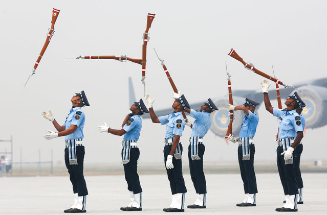 Indian Air Force soldiers toss their rifles as they perform during the full-dress rehearsal for Indian Air Force Day at the Hindon air force station on the outskirts of New Delhi, India, October 6, 2016. (Photo by Adnan Abidi/Reuters)