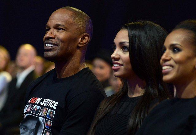 Jamie Foxx, Corinne Bishop and Kerry Washington watch the performances. (Photo by Jordan Strauss/Invision for MTV)