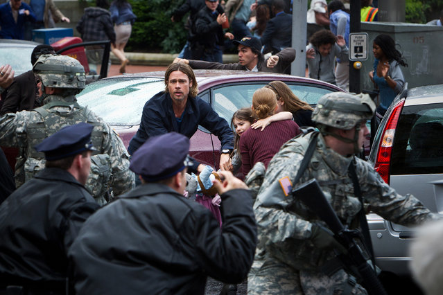 "June 21: ""World War Z"". Brad Pitt battles zombie apocalypse in $170 million film by ""Quantum of Solace"" director Marc Forster. This publicity photo released by Paramount Pictures shows, center, Brad Pitt as Gerald Lane in a scene from the film, ""World War Z"", from Paramount Pictures and Skydance Productions in association with Hemisphere Media Capital and GK Films. (Photo by Jaap Buitendijk/AP Photo/Paramount Pictures)"