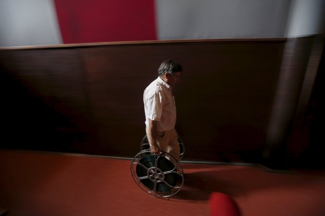 Projectionist Antonio Feliciano, 75, carries projection reels at Girasol cinema in Vila Nova de Milfontes, Portugal August 31, 2013. (Photo by Rafael Marchante/Reuters)