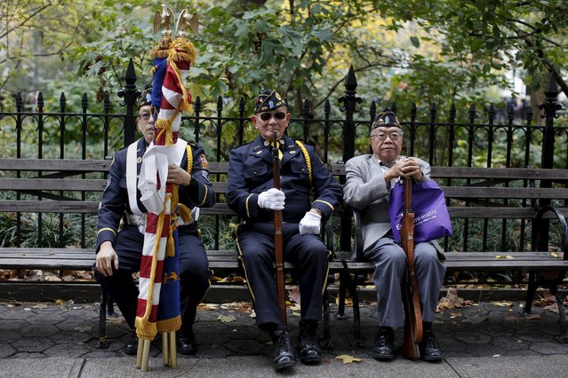 Men dressed in military clothes sit on a bench before the start of the Veteran's Day parade in New York November 11, 2015. (Photo by Shannon Stapleton/Reuters)