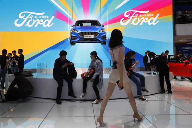 Attendees visit the Ford booth during Auto China 2018 show held in Beijing, China, Wednesday, April 25, 2018. Auto China 2018, the industry's biggest sales event this year, is overshadowed by mounting trade tensions between Beijing and U.S. President Donald Trump, who has threatened to hike tariffs on Chinese goods including automobiles in a dispute over technology policy. (Photo by Ng Han Guan/AP Photo)