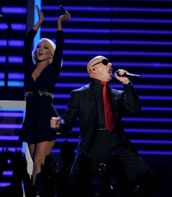 Christina Aguilera and Pitbull performs during the show. (Photo by Chris Pizzello/Invision)