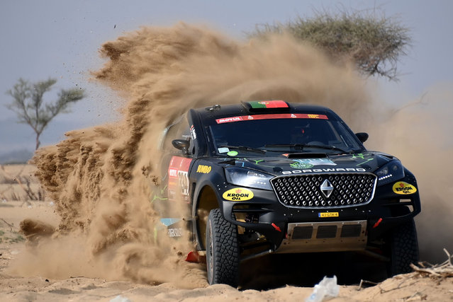 Portuguese driver Ricardo Poremi and co-driver Jorge Monteiro ride during a session on the eve of technical checkup in Jeddah, on December 31, 2020 ahead of the 2021 Dakar Rally, which this year will take place in Saudi Arabia from January 3 to 15, 2021. (Photo by Franck Fife/AFP Photo)
