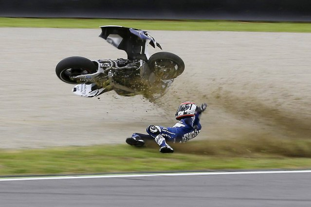 France's Randy De Puniet crashes during a free practice session for Sunday's Italian Moto GP, at the Mugello race circuit, in Scarperia, Italy, Saturday, June 1, 2013. (Photo by Antonio Calanni/AP Photo)