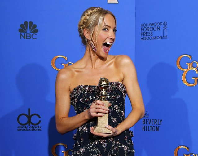 "Joanne Froggatt poses with her award for Best Supporting Actress in a Series, Mini-Series or TV Movie for her role in ""Downton Abbey"" backstage at the 72nd Golden Globe Awards in Beverly Hills, California January 11, 2015. (Photo by Mike Blake/Reuters)"