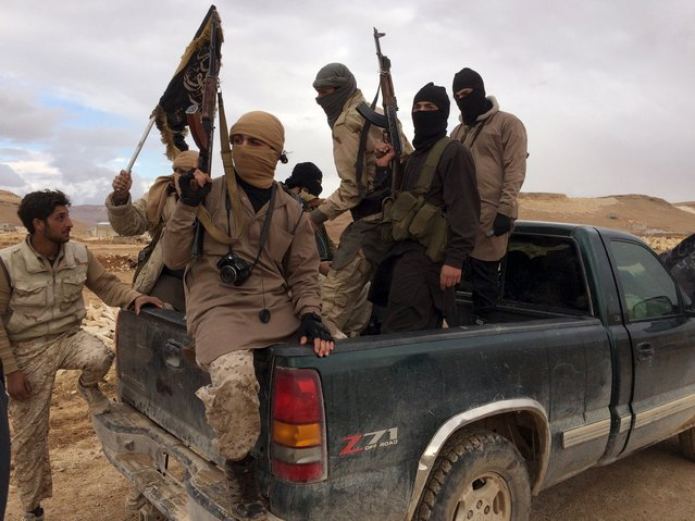 Al Qaeda-linked Nusra Front fighters carry their weapons on the back of a pick-up truck during the release of Lebanese soldiers and policemen in Arsal, eastern Bekaa Valley, Lebanon, December 1, 2015. (Photo by Reuters/Stringer)