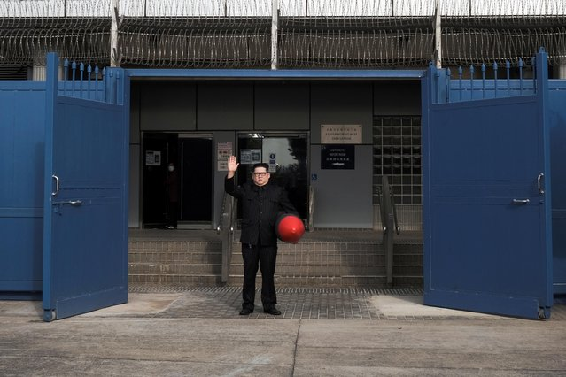 Howard X, an Australian-Chinese impersonating North Korean leader Kim Jong-un gestures as he stands with his inflatable rocket to report for his bail, outside the police station in Hong Kong, China on January 20, 2021. (Photo by Tyrone Siu/Reuters)