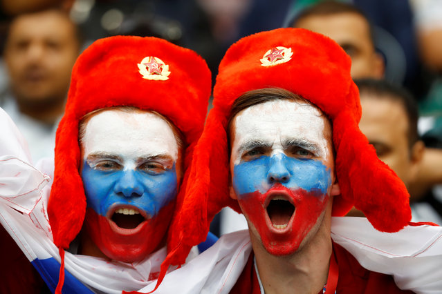 Russia fans with face paint before the Russia 2018 World Cup Group A football match between Russia and Saudi Arabia at the Luzhniki Stadium in Moscow on June 14, 2018. (Photo by Kai Pfaffenbach/Reuters)