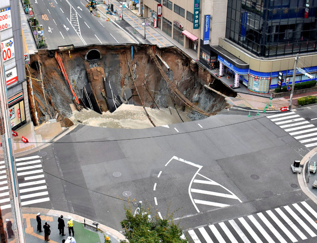 A huge sinkhole is seen at an intersection near Hakata station in Fukuoka, Japan, November 8, 2016 in this photo taken by Kyodo. (Photo by Reuters/Kyodo News)