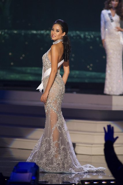 Elvira Devinamira, Miss Indonesia 2014 competes on stage in her evening gown during the Miss Universe Preliminary Show in Miami, Florida in this January 21, 2015 handout photo. (Photo by Reuters/Miss Universe Organization)