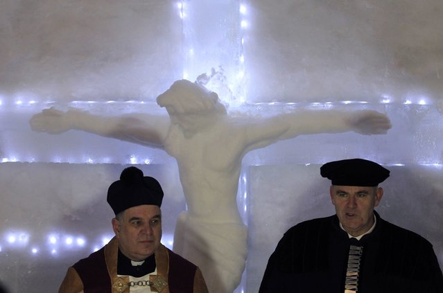 Romano Catholic archpriest Oskar Raicea (L) and Evangelic priest Michael Reger (R) attend the inaugural mass for a church made entirely from ice at Balea Lac resort in the Fagaras mountains January 29, 2015. (Photo by Radu Sigheti/Reuters)